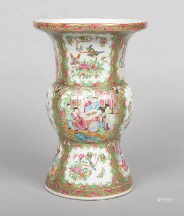 A 19th century Cantonese gu shaped vase. With a gilt and lotus scroll ground and painted with panels