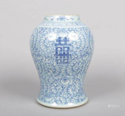 A 19th century Chinese blue and white baluster vase. Painted in underglaze blue with lotus scrolls
