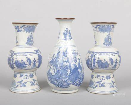 A garniture of three 20th century Chinese blue and white vases. Printed in underglaze blue with