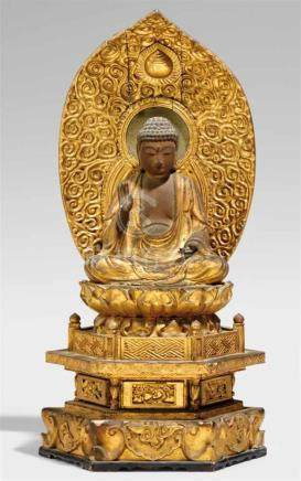 Amida Nyorai. Holz, über Schwarzlack vergoldet. 17./18. Jh.Im Meditationssitz auf einem doppelten