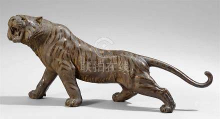 Brüllender Tiger. Bronze. Spätes 19. Jh.Sign. in Siegelschrift: Genryûsai Seiya seiSchreitend, mit
