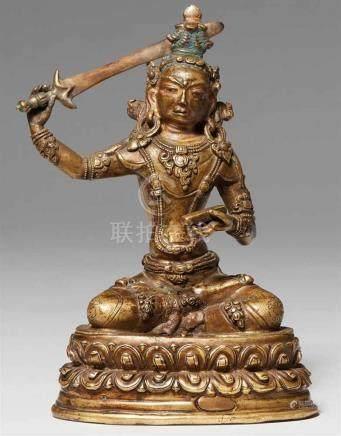 Figur des Manjushri. Bronze. Tibet. 15./16. Jh.Der Bodhisattva der Weisheit thront auf einem