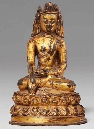 Buddha Shakyamuni/Vajrasana. Feuervergoldete Bronze. Tibet. 15./16. Jh.Der bekrönte Shakyamuni sitzt