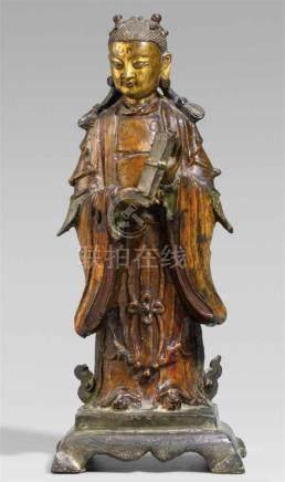 Weibliche Begleitfigur einer daoistischen Gottheit. Teilweise vergoldete Bronze. 17./18. Jh.