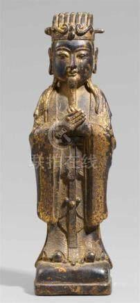 Vergöttlichter Kaiser. Bronze. Ming-Zeit, wohl 17. Jh.Stehend, auf rechteckigem Sockel, beide