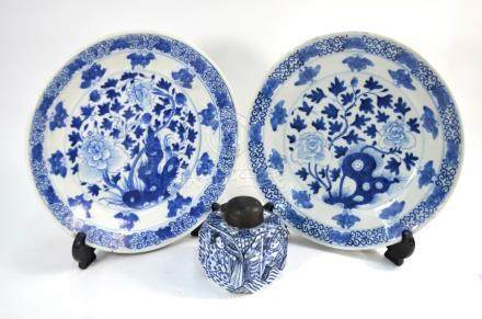 A pair of blue and white Chinese or Japanese dishes and a blue and white ink well