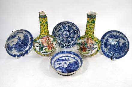 A pair of Chinese bottle vases and four Chinese blue and white saucer dishes; Qing Dynasty or later