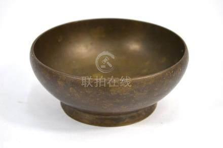 A circular bronze bowl