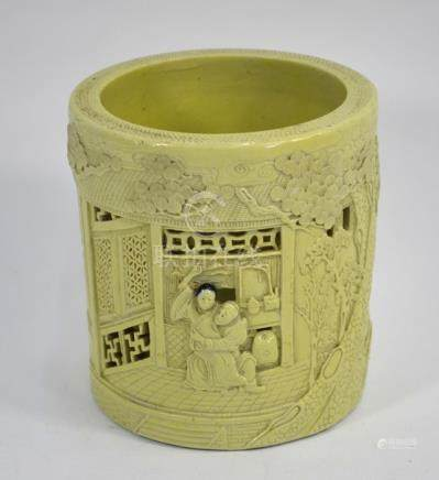 A Chinese biscuit porcelain brush pot