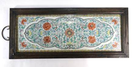 A Chinese porcelain doucai rectangular plaque decorated with bold floral designs