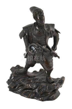 A Japanese metal okimono of a standing Samura