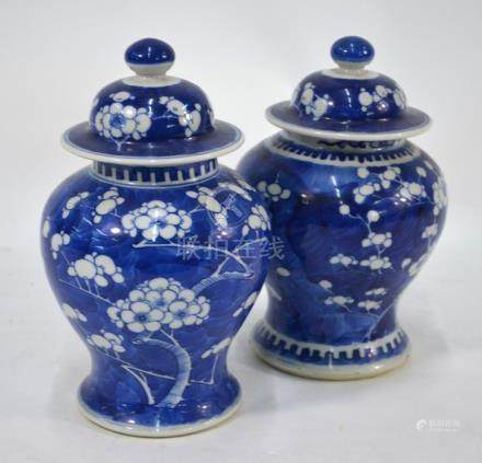 A matched pair of Chinese porcelain blue and white baluster vases and covers