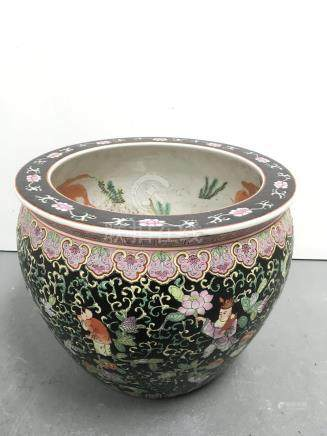 A modern Chinese fish bowl ,the black ground painted with figures.Approx 31x36cm