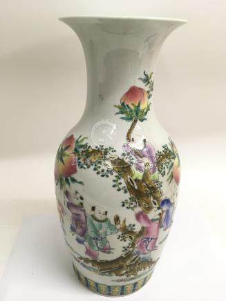 A Chinese famille rose vase painted with figures picking peaches. Approx 43cm, a/f
