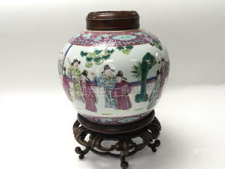 A 19th Chinease Export Porcelain vase with a hard wood cover and conforming stand. The sides
