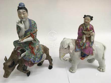 Two Chinese porcelain animal models comprising a musician on an ox and a lady seated on a elephant.