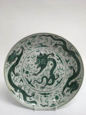 A Chinese porcelain 'dragon' dish painted in green enamels.Approx 28cm diameter