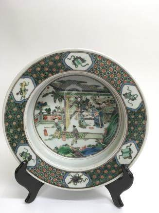 A fine, Chinese famille Vert large basin painted with with courtly figures in a garden, the rim