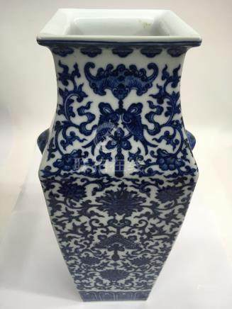 A large Chinese porcelain blue and white vase of square form, having profuse scrollwork decoration