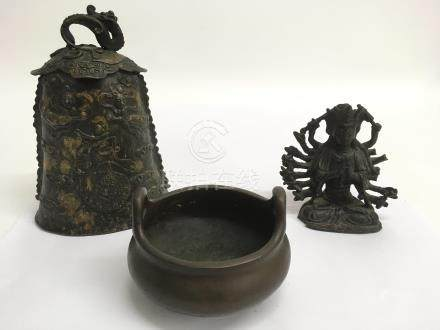 Three bronzes comprising a small Chinese censor, a temple bell decorated in relief with flying