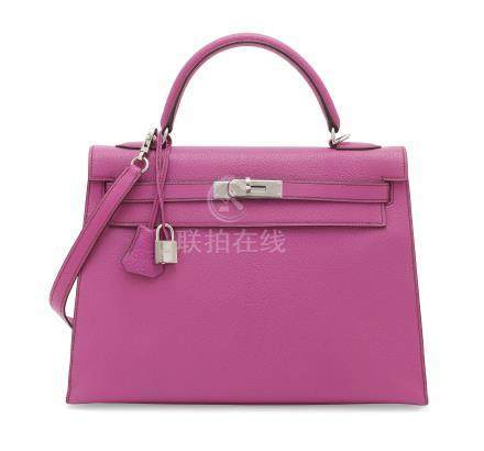 A FUCHSIA CHÈVRE LEATHER SELLIER KELLY 32 WITH PALLADIUM HARDWARE