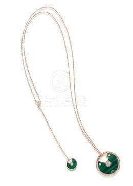 A Malachite and Diamond 'Amulette de Cartier' Pendant Necklace, by Cartier