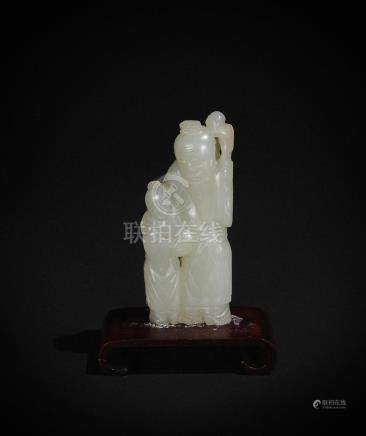 SMALL CHINESE CARVED JADE SHOU & BOY, 18-19TH CENTURY