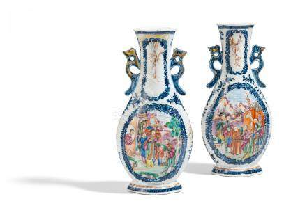 A PAIR OF BEGONIA SHAPED VASES WITH HANDLES.