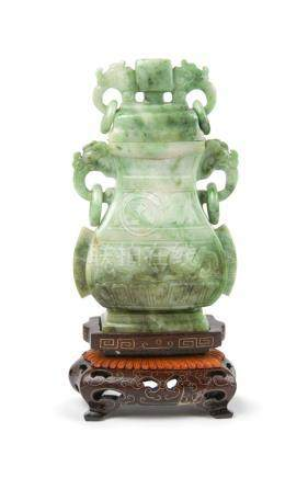 AN ARCHAISTIC JADEITE VASE AND COVER ON STAND