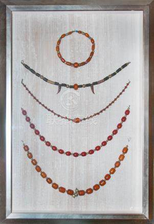 A RARE AND FINE SET OF BEAD NECKLACES WITH FRAME
