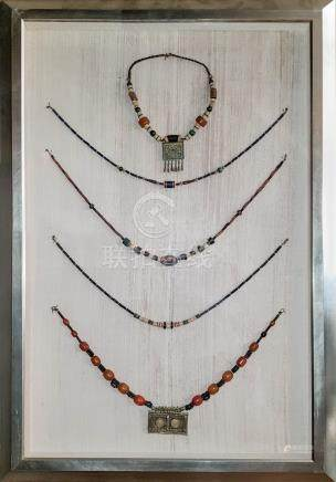 A FINE SET OF NECKLACES WITH FRAME