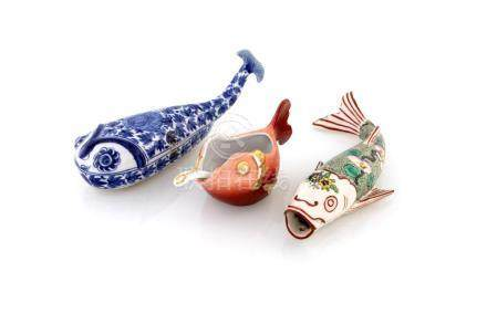 Lot of three porcelain fish figures