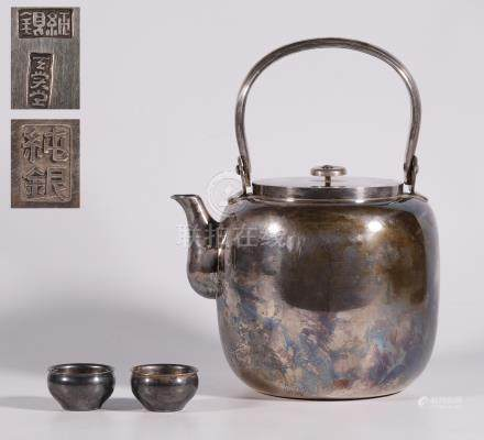 Japanese silver teapot with a set of cups