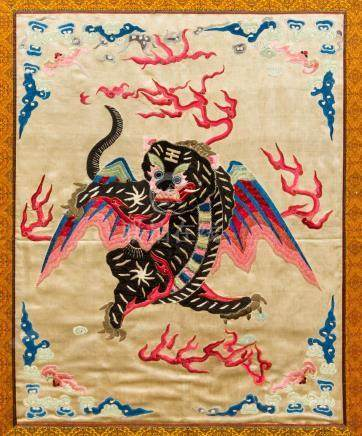 A late 19th/early 20th century Chinese silkwork picture Worked with a mythical beast amongst