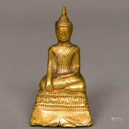 A Sino-Tibetan small antique unmarked high carat gold clad Buddha Typically modelled seated in the