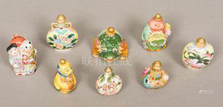 Eight Chinese porcelain snuff bottles and stoppers Various moulded/decorated.
