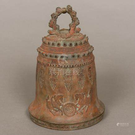 An Eastern, possibly Tibetan, patinated bronze bell Of typical domed form,