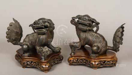 A pair of Chinese 18th/19th century patination bronze models of fo dogs Each typically modelled,