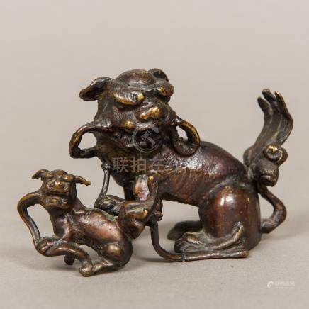 A Chinese patinated bronze group, possibly 18th century Modelled as two dogs-of-fo. 13 cm wide.