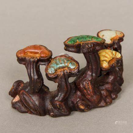 A Chinese patinated bronze brush rest Set with various specimen hardstones. 12.5 cm wide.