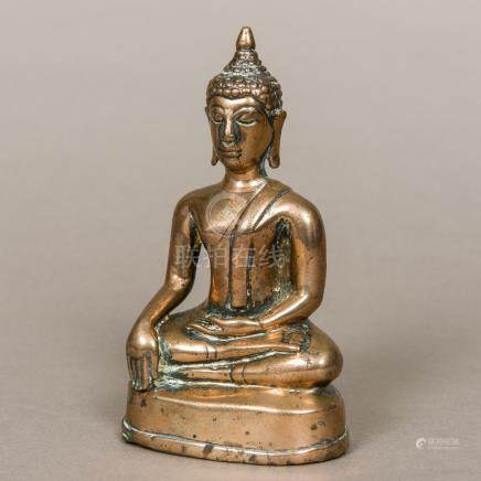 An antique bronze Buddha Typically modelled seated in the lotus position wearing a headdress.