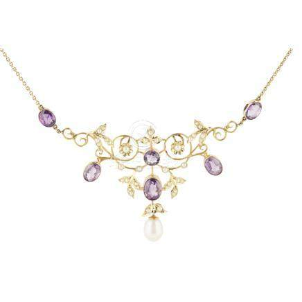 An Edwardian amethyst and seed pearl necklace of open scrolling design, set throughout with seed