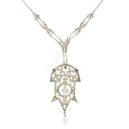An early 20th century paste set pendant the stylised plaque with pierced foliate detail, set