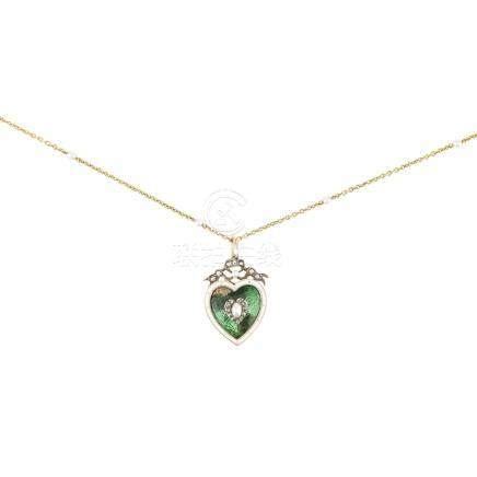 An enamel, pearl and diamond set pendant of heart-shaped outline, the green enamelled ground in a