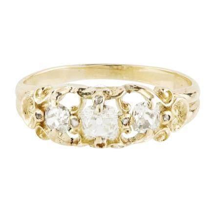 A Victorian three stone diamond set ring claw set with three graduated old cushion cut diamonds,