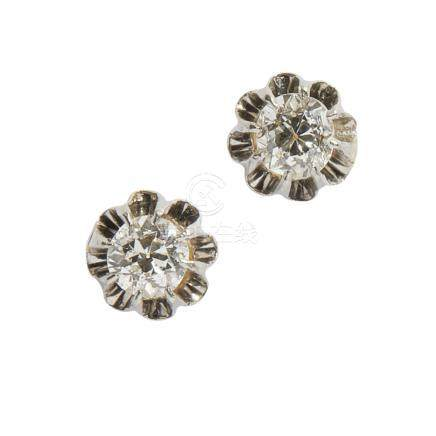 A pair of diamond set ear studs each claw set with an old round cut diamond, to post and tension