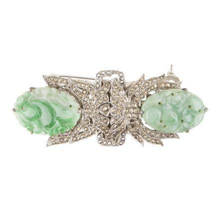 An Art Deco marcasite and jade set double clip brooch of symmetrical form, each half with a carved