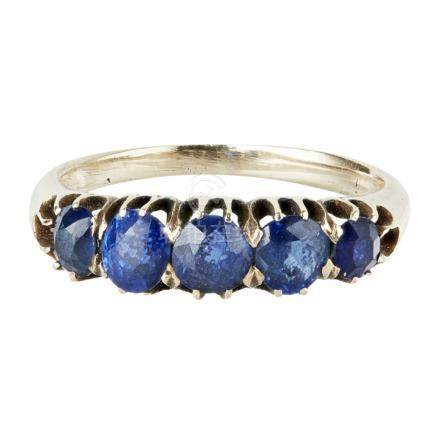 A five stone sapphire set ring claw set with five graduated sapphires, to a plain yellow metal