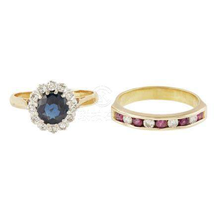 A sapphire and diamond cluster ring the round mixed cut sapphire within a surround of round
