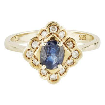 A sapphire and diamond set cluster ring claw set with an oval sapphire, in a border of round